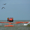 March 2014 Oil Spill Response : As the oil spill in Galveston Bay expands, the U. S. Coast Guard places booms to guard the shores and bird habitats in Matagorda Bay.